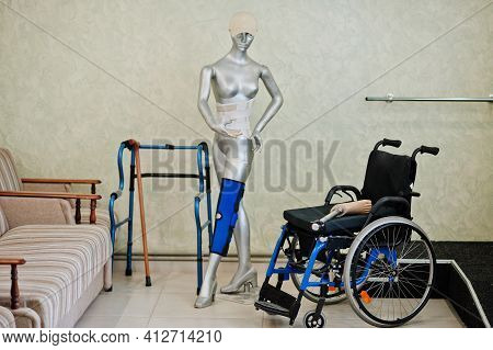 Wheelchair And Mannequin At Prosthetist Clinic. Health Care