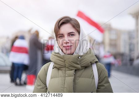Belarusian Woman Standing Group Of Protesters With Belarusian Flags On Background On Peaceful Protes