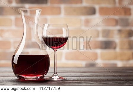Wine decanter and glass of red wine. With copy space