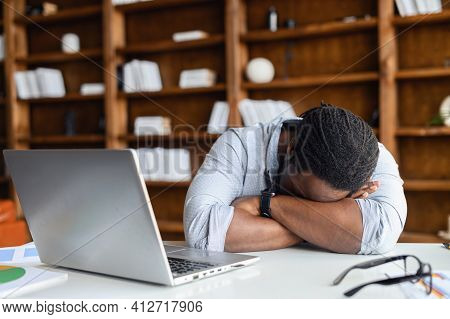 African-american Tired Deprived Businessman Feeling Lack Of Sleep Having Nap At Workplace, Black Res