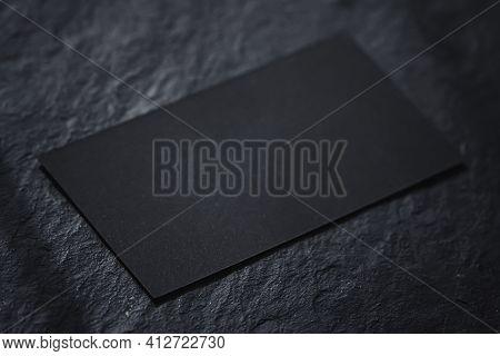 Black Business Card On Dark Stone Flatlay Background And Sunlight Shadows, Luxury Branding Flat Lay