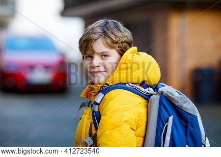 Little School Kid Boy Of Elementary Class Walking To School. Portrait Of Happy Child On The Street W