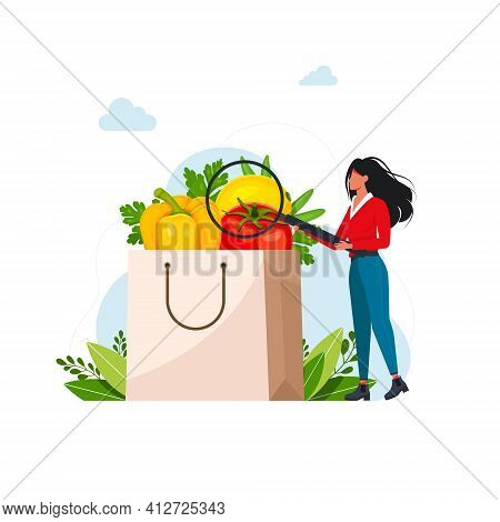 People Keeping Healthy Diet. Woman Examines In A Magnifying Glass Paper Bag With Fresh Fruit And Veg