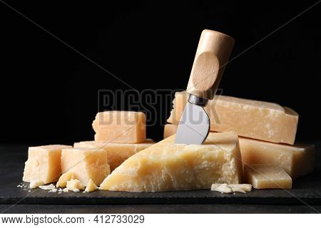 Parmesan Cheese With Slate Plate And Knife On Table, Closeup