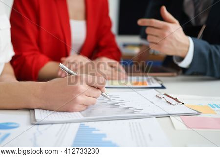 Group Of People Are Studying Information On Graph Closeup
