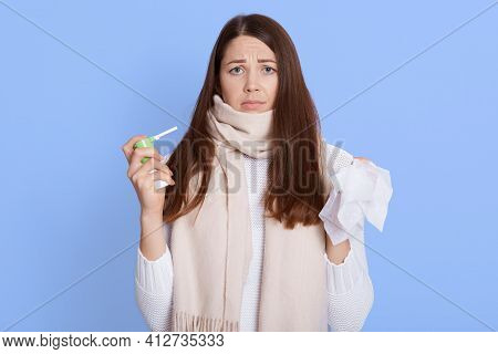 Attractive Sick Dark Haired Woman Don't Want To Use Spray To Treat Sore Throat, Looking Tired And Fe
