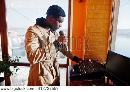 African American Young Sound Producer Working At Studio.
