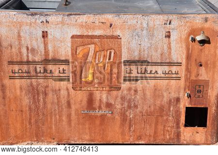 Maricopa, Arizona, February 26, 2021: The Old Rusty Ice Cooler With The 7-up Pop Logo Is An American