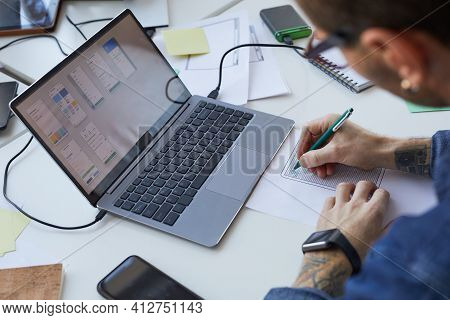 High Angle View At Male Software Engineer Designing Interface For Mobile Application Or Website, Foc