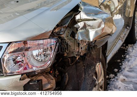Damaged Car Detail On Crushed Car, Wrecked Vehicle. Crushed Metal And Plastic After A Traffic Accide