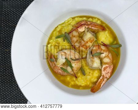 Shrimp Risotto. Gourmet Food. Seafood Restaurant. Gastronomy.