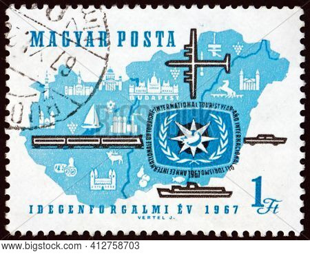 Hungary - Circa 1967: A Stamp Printed In Hungary Shows Map Of Hungary, Tourist Year Emblem, Plane, T