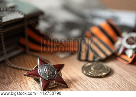 Order Of Red Star On Blurred Background With St. George's Ribbon And Medals. 9 May Greeting Card. Tr