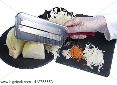 Women's Hand With Chopping Knife Cuts Cabbage On Cutting Board Preparing Chopped Salad Isolated On W