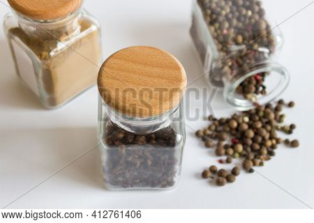 Closeup Mockup Template With Three Jars Glass Hermetic Bottles With Wooden Caps And Spices Seasoning