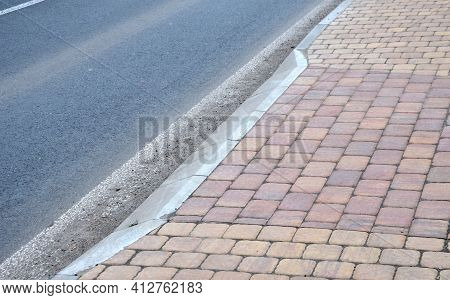 Entrance To The Yard From The Road. The Curb Is Chamfered So That It Travels Well. It Is Color Contr