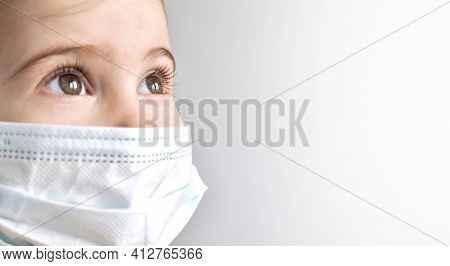 Coronavirus Covid-19. Little Child Girl Wearing Protection Face Medical Mask On Grey Background. Sta