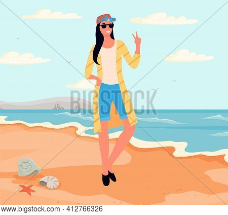 Woman Standing On Coastline, Pointing Fingers Up To Sky. Girl Posing Near Sea For Photography