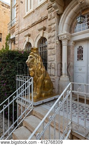 Jerusalem, Israel, February 27, 2021 : Evening View Of A Large Gilded Statue Of The Lion Of Jerusale