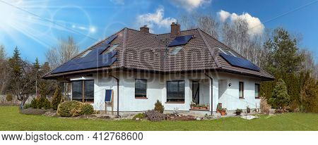 Solar Panels Installed On The Roof Of A Large Family House.