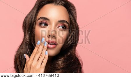 Beautiful Woman Showing Blue  Manicure Nails . Makeup And Cosmetics. Brunette  Girl With Long  And