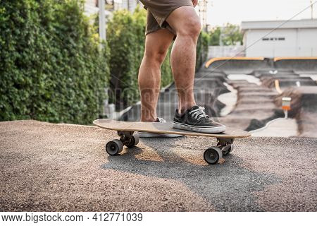 Closeup Asian Man Holding Surfskate Or Skate Board In Pumptrack Skate Park When Sunrise Time Over Ph