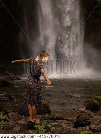 Caucasian Woman Enjoying Waterfall Landscape. Nature And Environment Concept. Travel Lifestyle. Woma