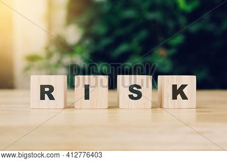 Word Risk Block Wood On Wooden Table Background. Risk Business Concept.