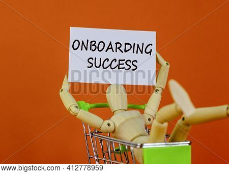 Onboarding Success Symbol. White Paper. Words 'onboarding Success'. Wooden Model Of A Human In A Sho