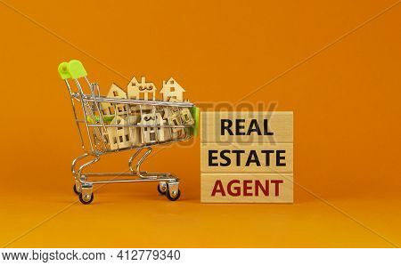 Real Estate Agent Symbol. Wooden Blocks With Words 'real Estate Agent' On Beautiful Orange Backgroun