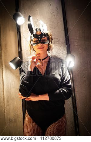 Sexy Woman In Black Underwear In Bdsm Bunny Leather Mask And Accessories.