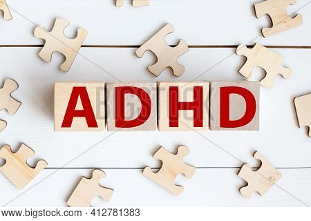 Adhd .attention Deficit Hyperactivity Disorder. Text On Wood Cubes. Text In Black Letters On Wood Bl