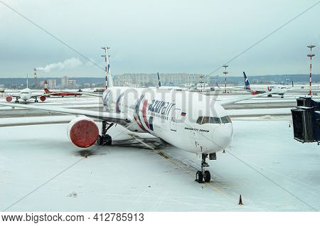 Moscow, Russia: 03.15.2021 - Boeing 777-300 Er Of Azur Air Airlines Parked At The Airport. Winter Vi