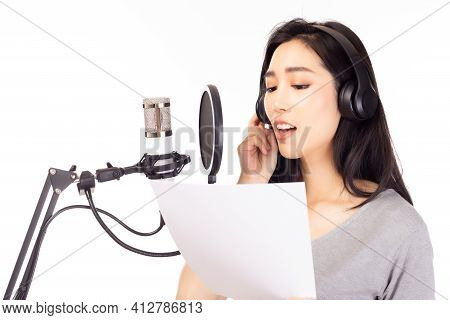 Singer Female Singing Song By Reading Note On Paper In Recording Studio, Using Microphone, Pop Filte