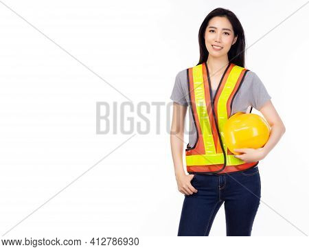 Portrait Engineer Woman Holding Safety Hard Hat, Wear Reflective Vest And Jeans Worker Female Look S