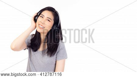 Gorgeous Asian Woman Listening Music In Headphones And Singing Song With Isolated On White Backgroun