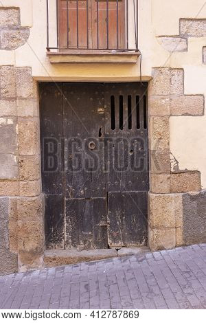 Old Wooden Door With Stone Arch, In Girona, Catalonia, Spain