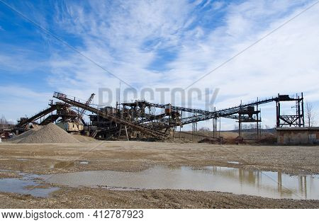 Crushing Machinery, Cone Type Rock Crusher, Conveying Crushed Granite Gravel Stone In A Quarry Open