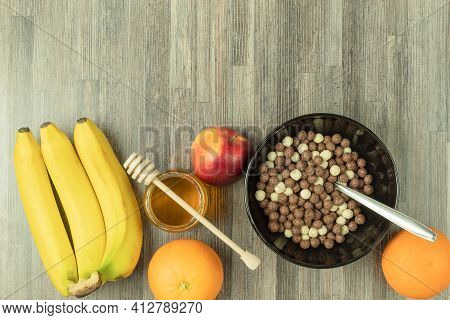 Flakes With Milk And Fruit For Breakfast. Round Flakes In Chocolate With Milk And Honey. A Bowl Of C