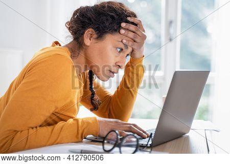Black Woman Worried Reading Bad News On Internet