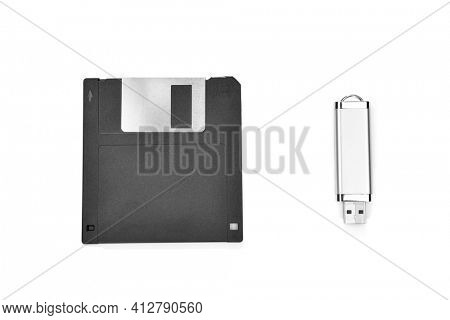 Front view of an old floppy disk and memory stick isolated on white background
