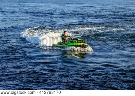 Kherson, Ukraine - July 22, 2020: An Adult Man Rides A Jet Ski On The Dnieper River In Kherson (ukra