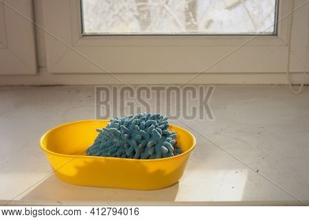 Blue Cloth Lies In Yellow Bucket On White Dirty Windowsill, Prepare For Cleanup