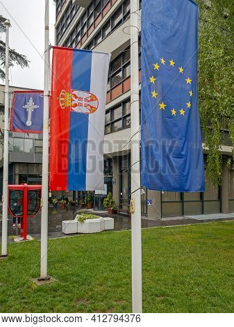 Belgrade, Serbia - May 02, 2020: Serbian And Eu Flags In Front Of Government Building At Vracar.