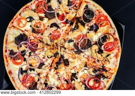 Delicious Pepperoni Pizza And Basil Tomato Ingredients On A Black Concrete Background. Top View Of H