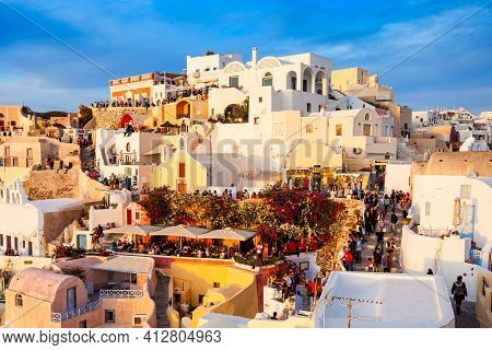 Santorini Island, Greece - October 26, 2016: Oia Town Aerial Panoramic View On Sunset. Oia Or Ia Is