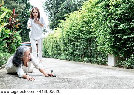 Elderly Asian Woman Falling, Lying On The Road Floor She Is A Patient Of Osteoarthritis, That Need A