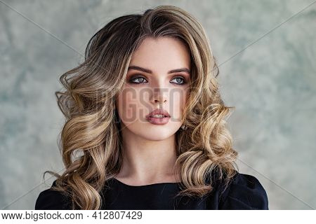 Lovely Woman Model With Curly Hairstyle On Gray Background Portrait