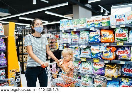 Budva, Montenegro - 17 March 2021: Shopping With Children During The Coronavirus Epidemic. Mother An
