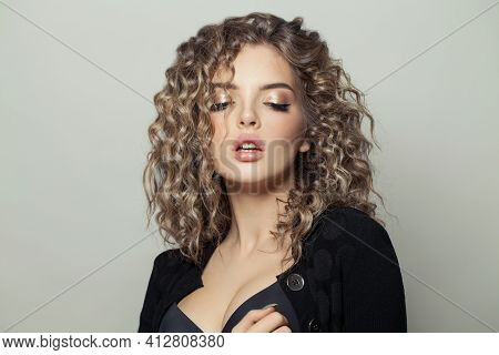 Attractive Fashionable Woman With Curly Hairstyle On White Background. Portrait Of Curly Haired Fema